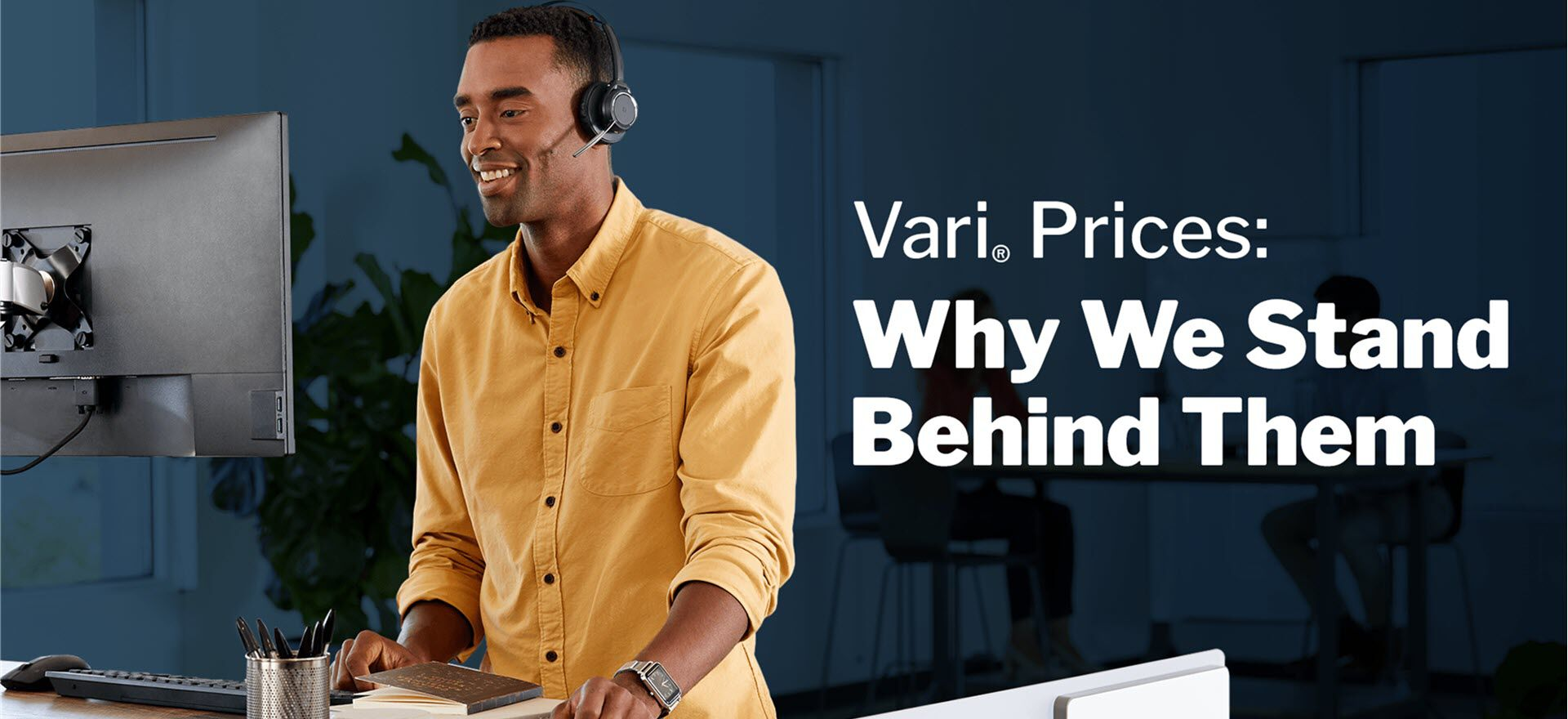 professional working at vari table with headset with the following text - vari prices why we stand behind them
