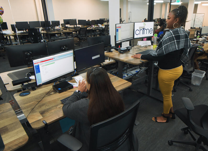 vari electric standing desks in use at Chime solutions headuarters  image