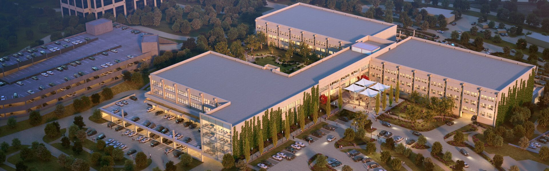 exterior of the Las Colinas location as seen from above, with lush outdoor spaces and a modern feel