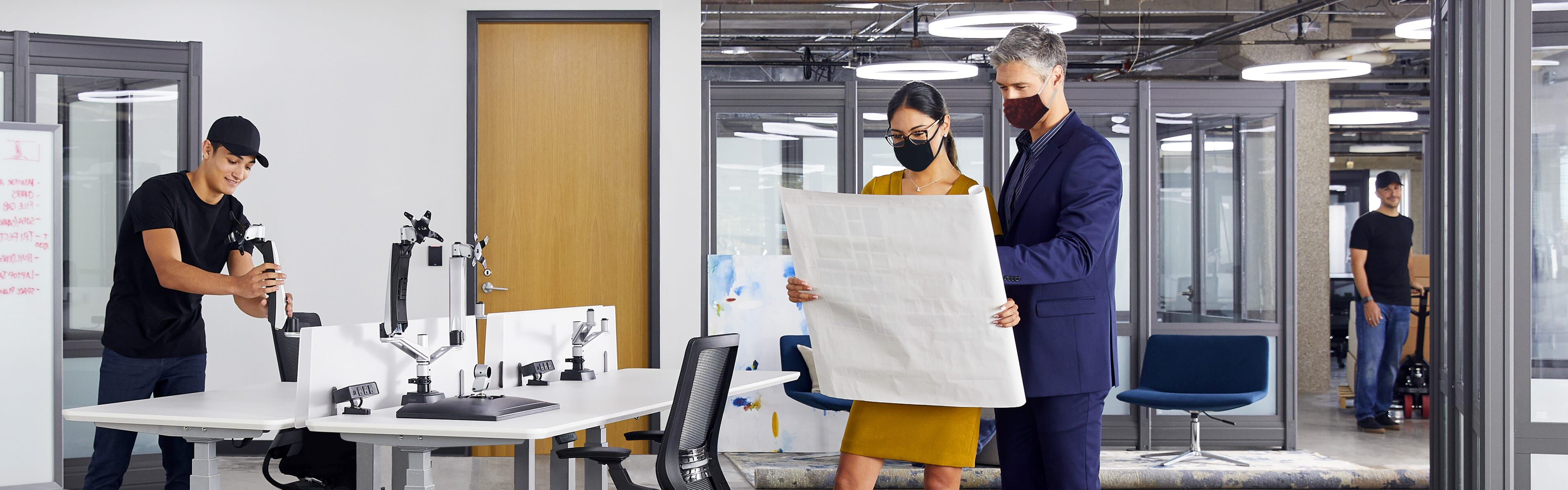 people reviewing a space plan in an office undergoing a furniture design project