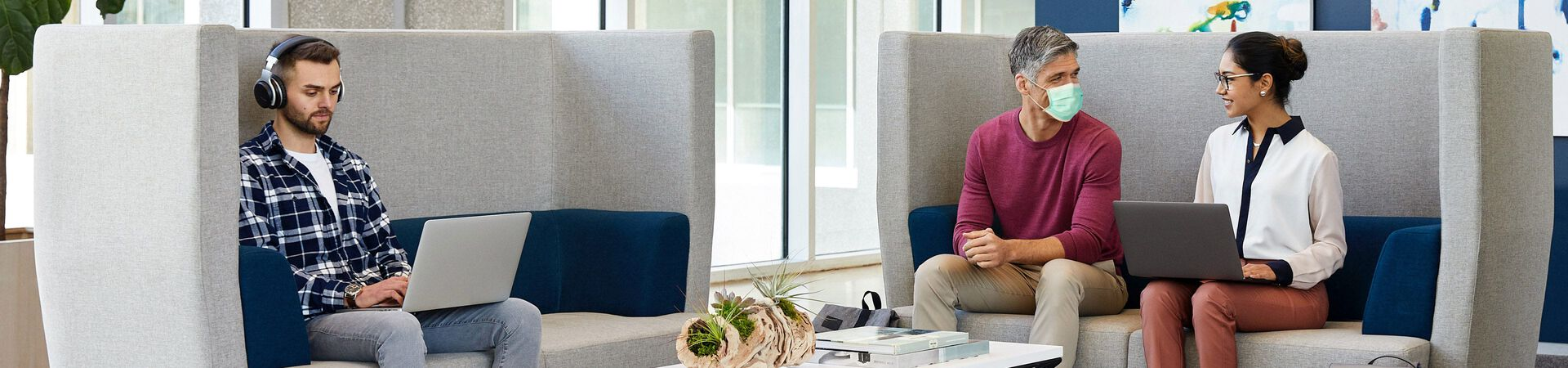 two professionals hold a private casual meeting on Vari soft seating