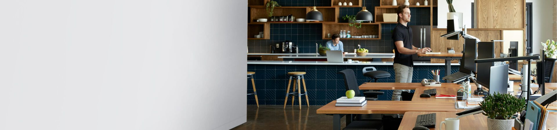 standing desks, office chairs, and other office furniture in an open workspace