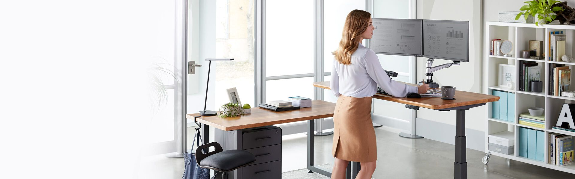 professional works in airy private office while standing
