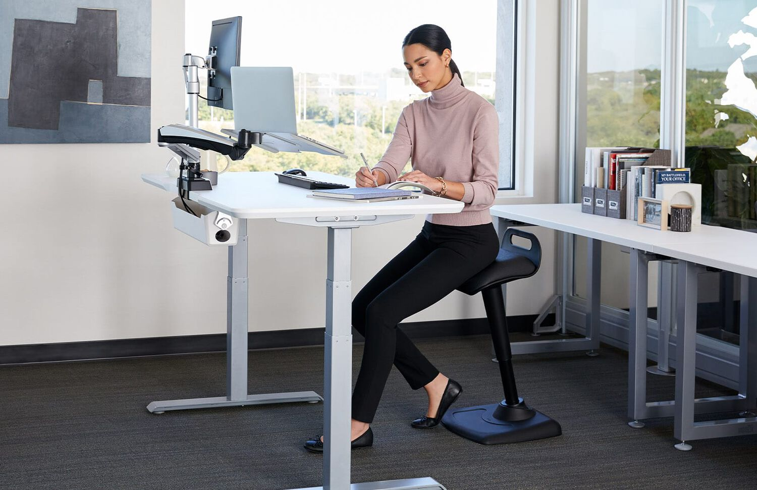 professional working while seating on active seat in office of vari products