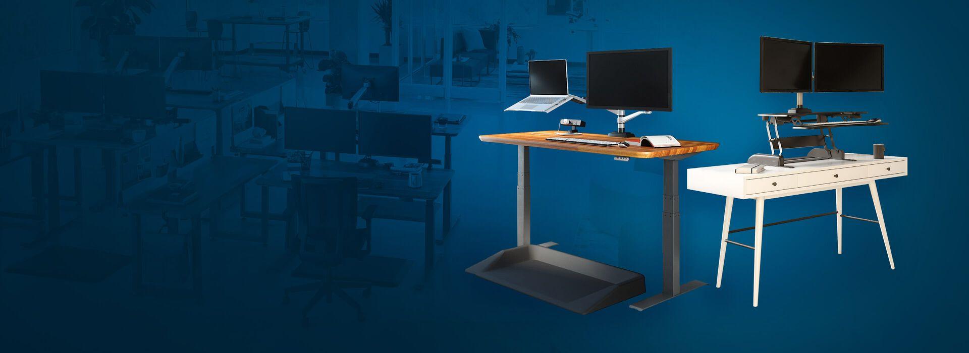 electric standing desk in raised position next to a varidesk converter ontop of white desk