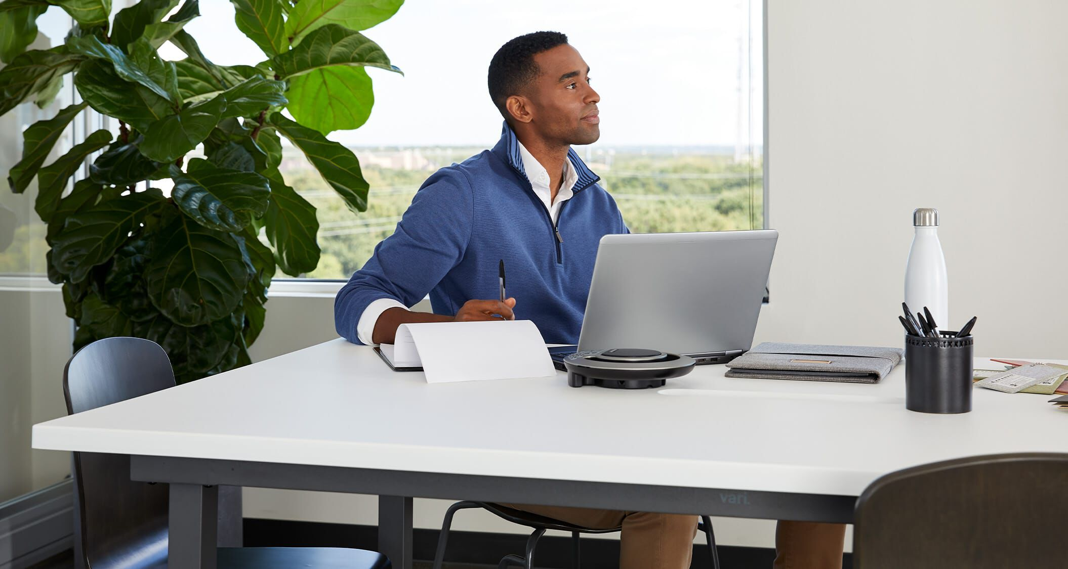 professional seated at vari conference table in conference room setting