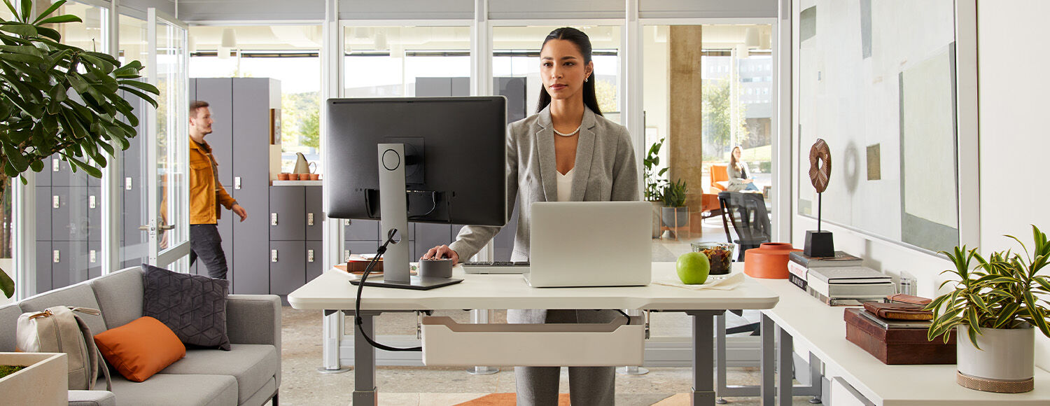 professional working at standing desk in corporate office