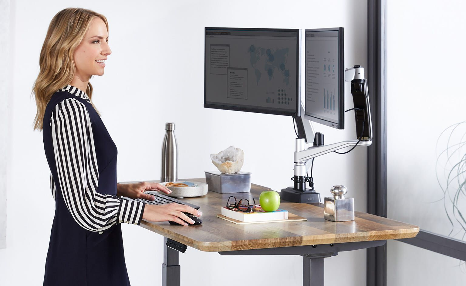 Vari Electric Standing Desk with dual monitor arms