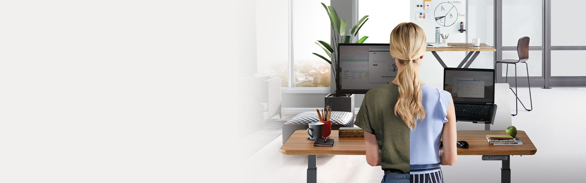 professional working at electric standing desk in a home and professional office