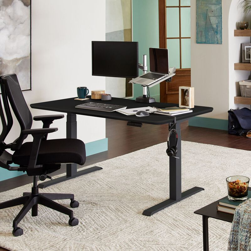 Electric Standing Desk 60x30 Black in lowered position at home image number null