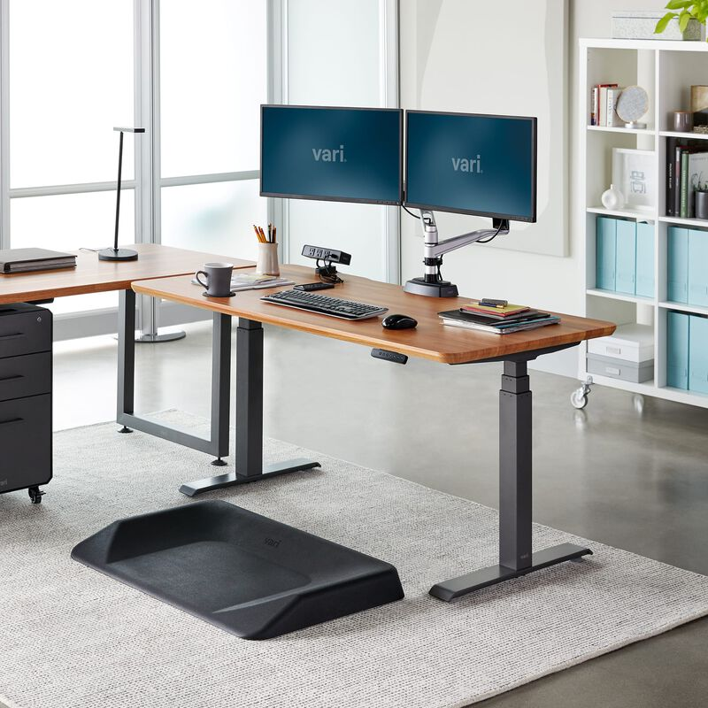 Electric Standing Desk 60x30 Butcher Block in lowered position at office image number null