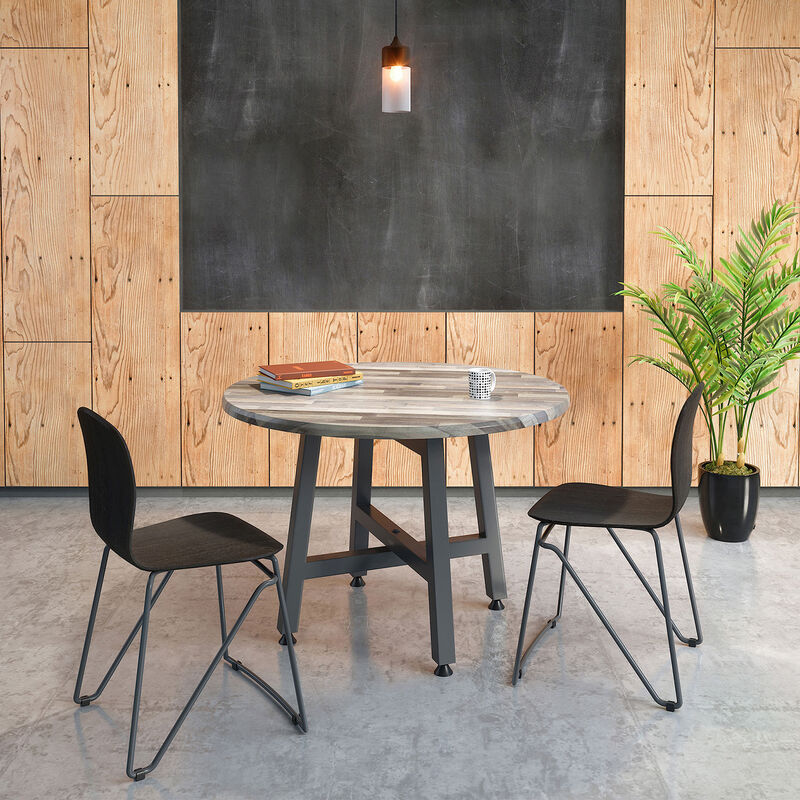 Two side chairs next to a round table in break area image number null
