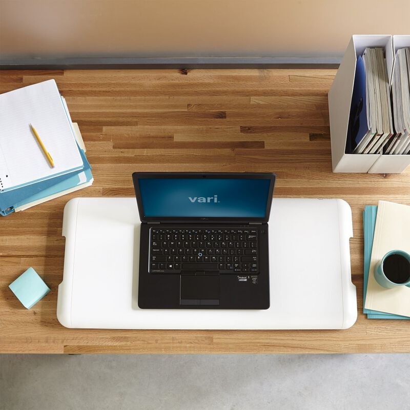 Overhead view of the VariDesk Soho in white on existing desk in office image number null