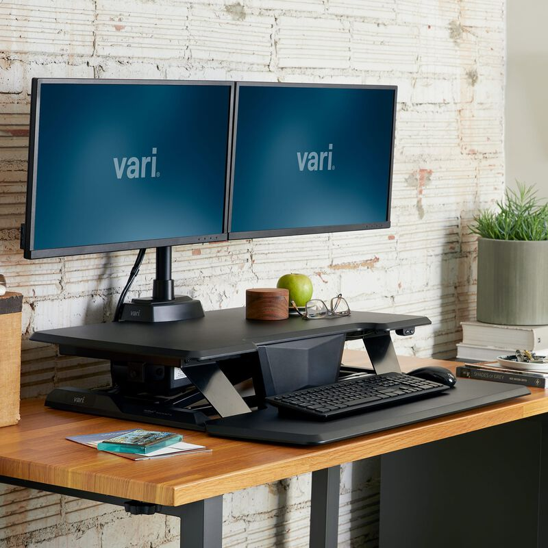 VariDesk® Electric Pro Plus™ 32 Black in lowered position at office image number null