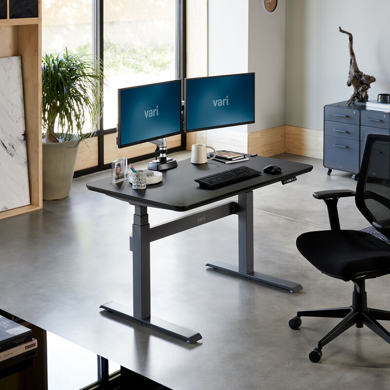 Electric Standing Desk 48x30 Black in lowered position at office image number null