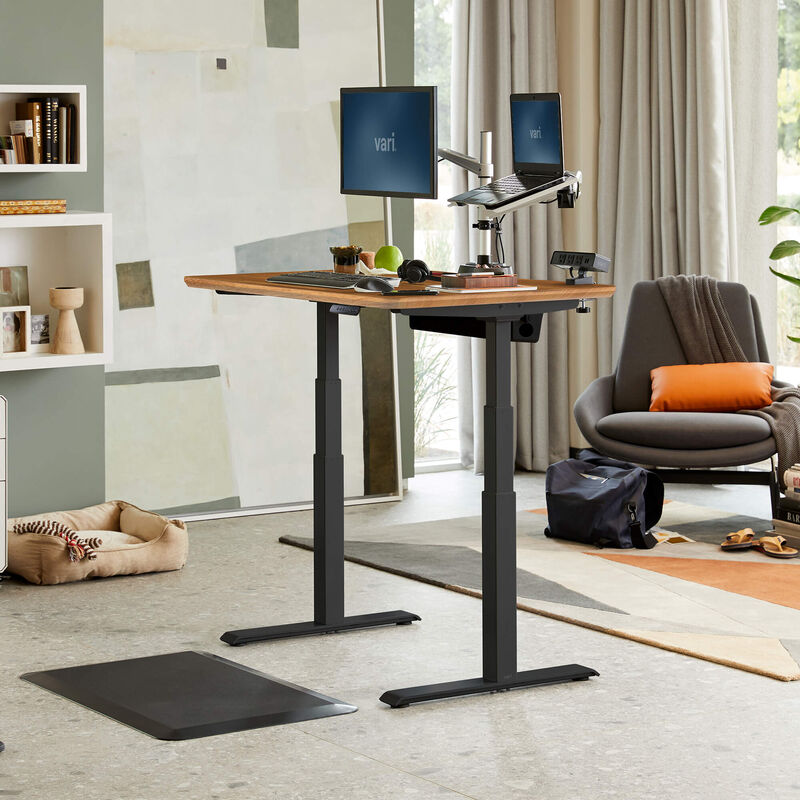 Electric Standing Desk 48x30 Butcher Block in raised position at home image number null