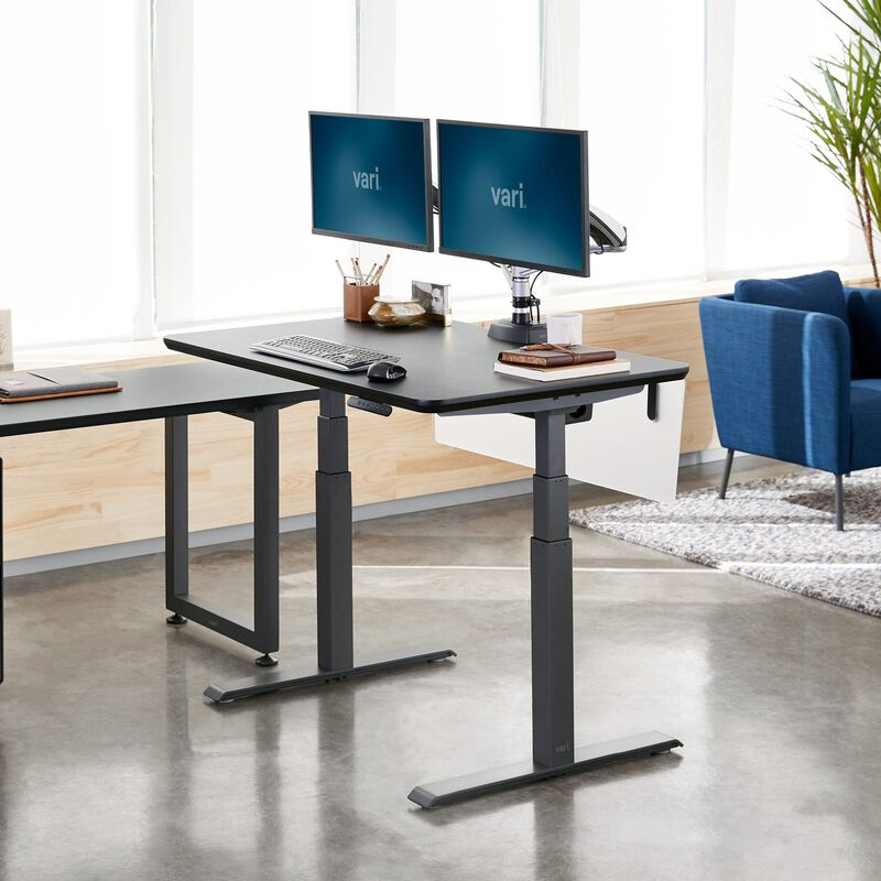 Electric Standing Desk 48x30 Black in raised position at office image number null