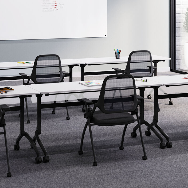 vari flip top training table five foot in white, nesting training chair, and flip top training table modesty panel five foot setup in an office training room. image number null