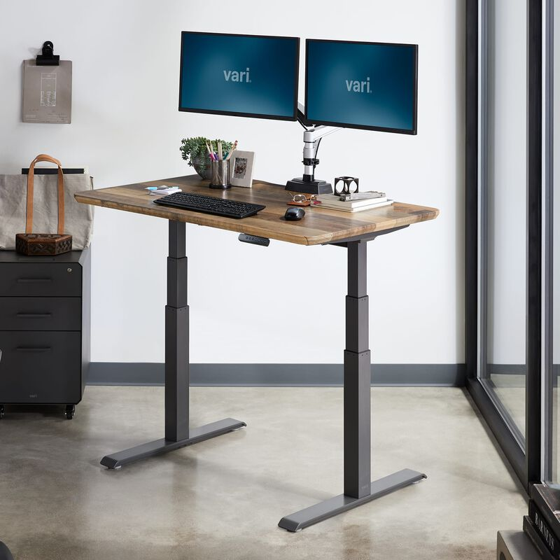 Electric Standing Desk 48x30 Reclaimed Wood in raised position at office image number null