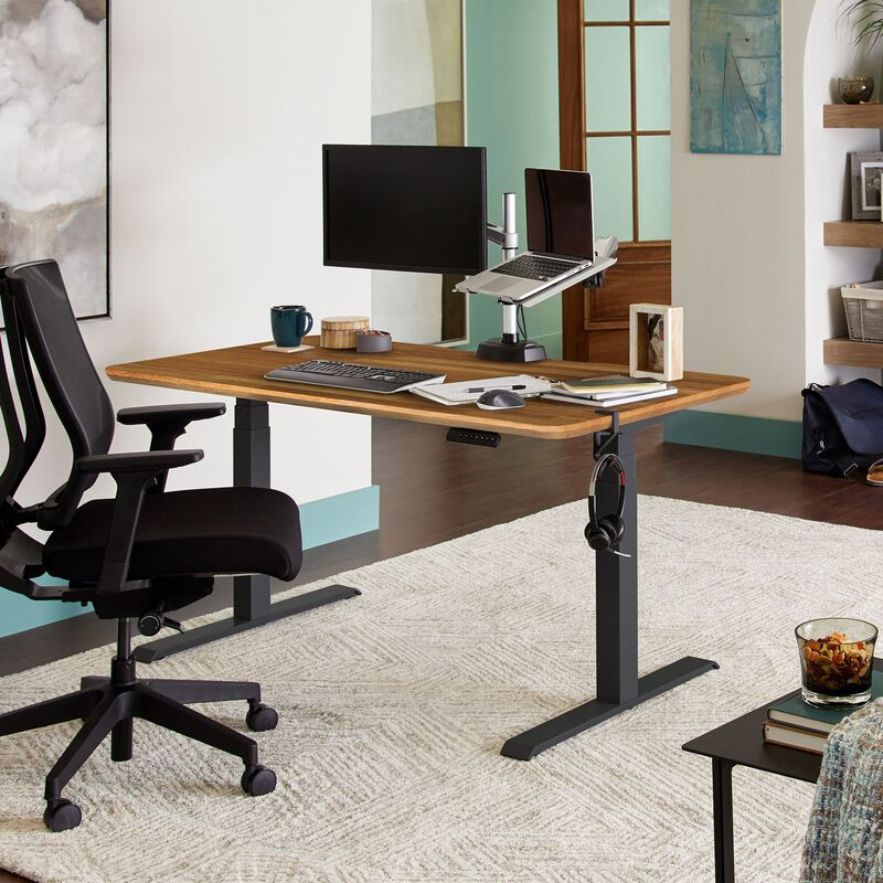 Electric Standing Desk 60x30 Butcher Block in lowered position at home image number null