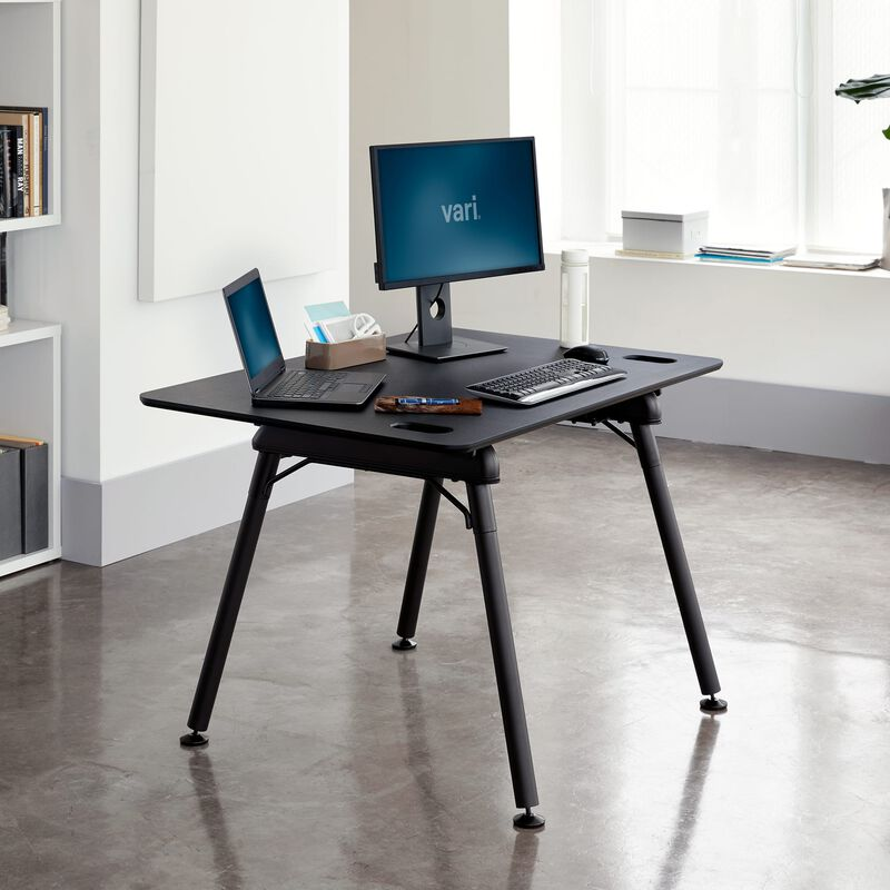 Standing Desk 48x32 Black in lowered position at office image number null