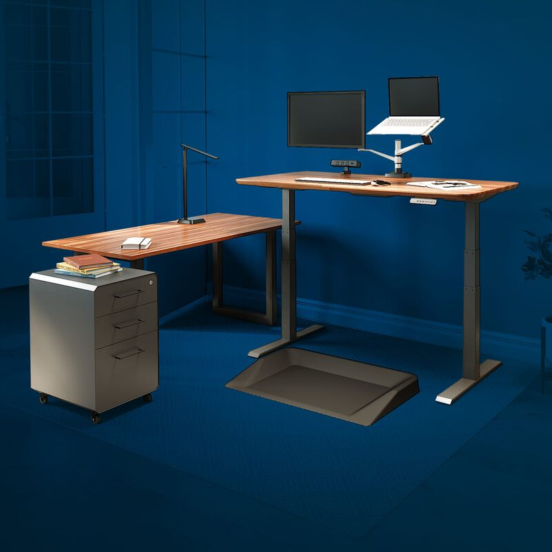 vari electric standing desk, table, and accessories in home office with blue background to highlight vari products image number null