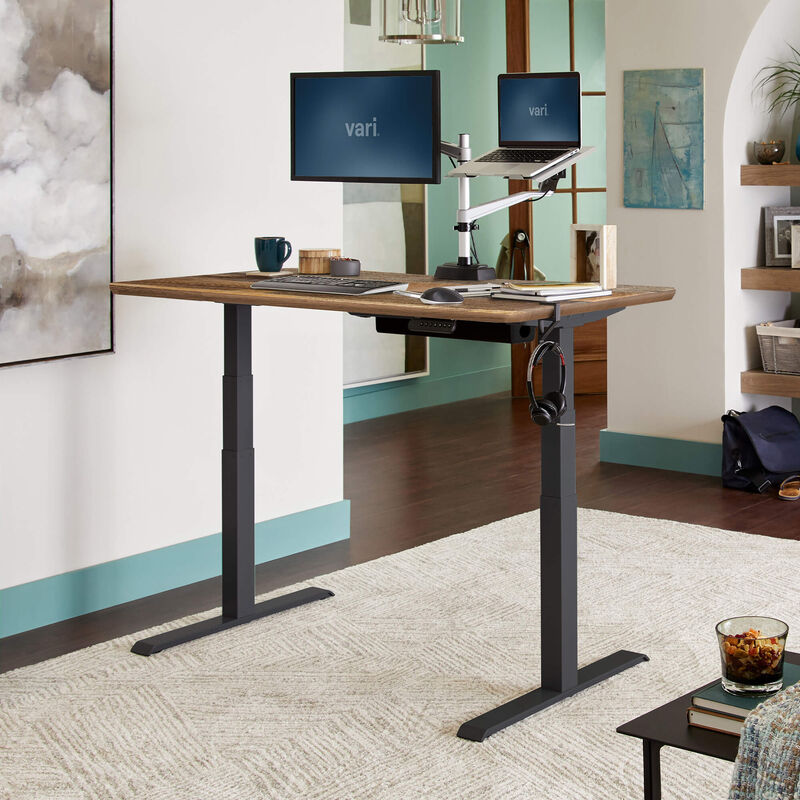 Electric Standing Desk 60x30 Reclaimed Wood in raised position at home image number null