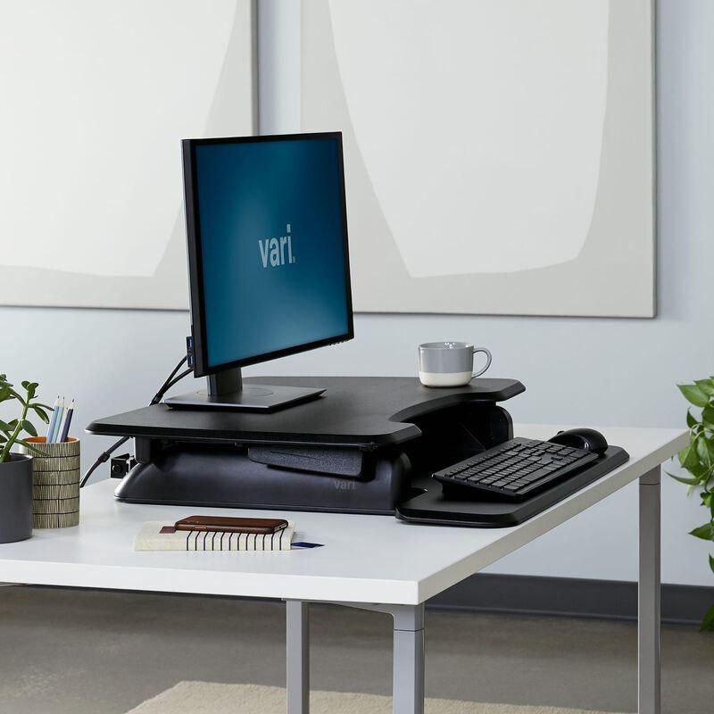 varidesk basic 30 in black lowered on top of existing desk image number null