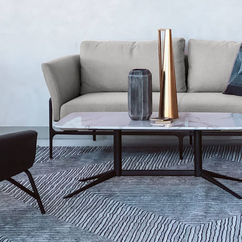 contemporary three-seat sofa in silver grey placed in office setting with the contemporary coffee table image number null