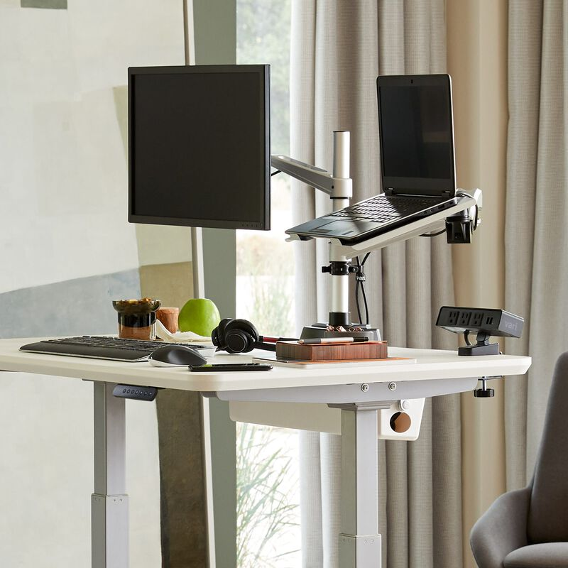 monitor arm plus laptop stand mounted on desk in home setting image number null