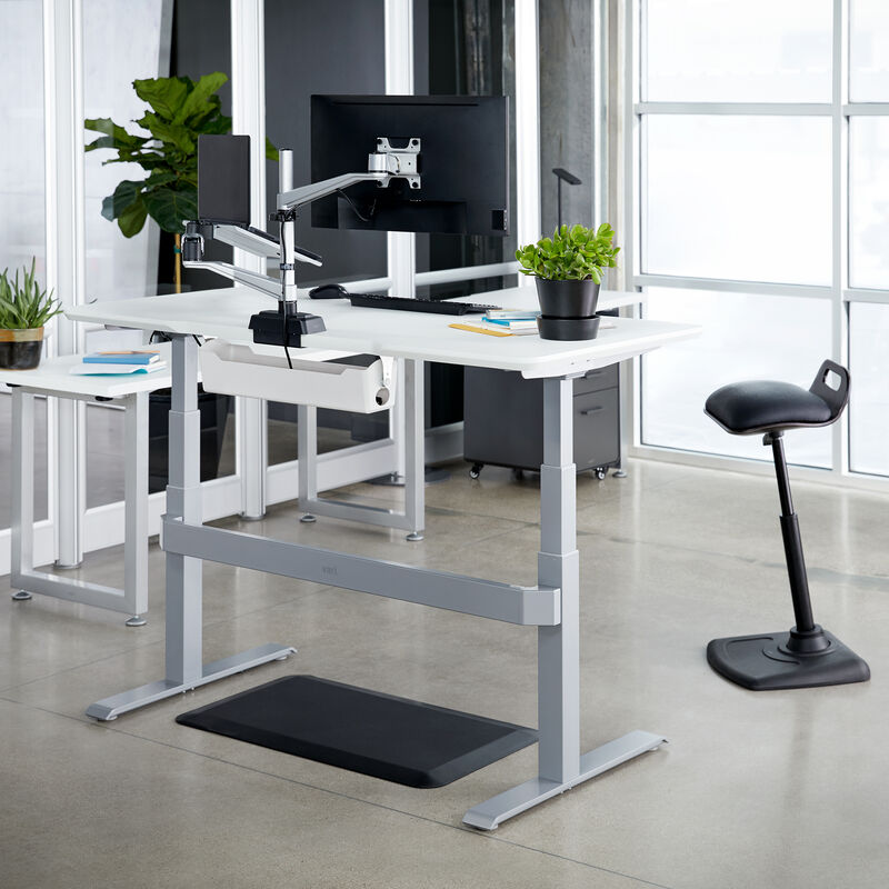 Electric Standing Desk 60x30 White in raised position at office image number null