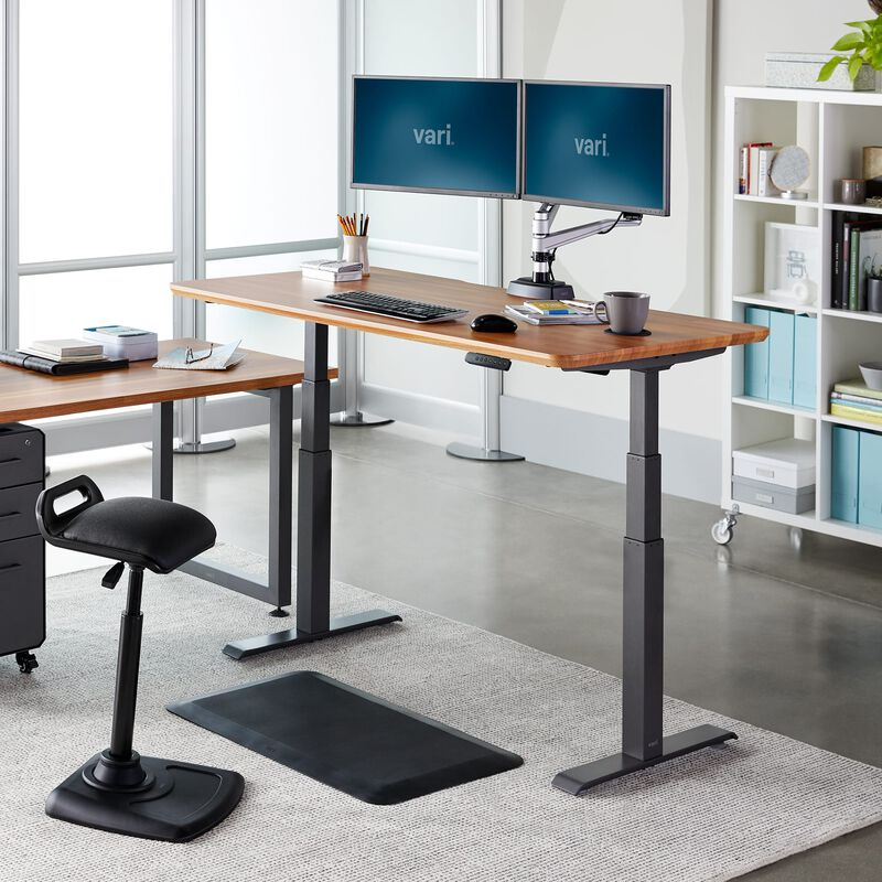 Electric Standing Desk 60x30 Butcher Block in raised position at office image number null