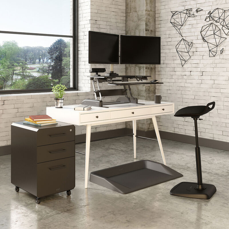VariDesk converter on white desk in office with brick wall image number null