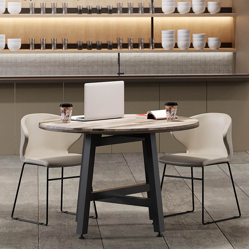 sand grey cafe chairs around round table in lounge setting image number null