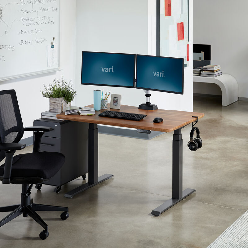 Electric Standing Desk 48x30 Butcher Block in lowered position at office image number null