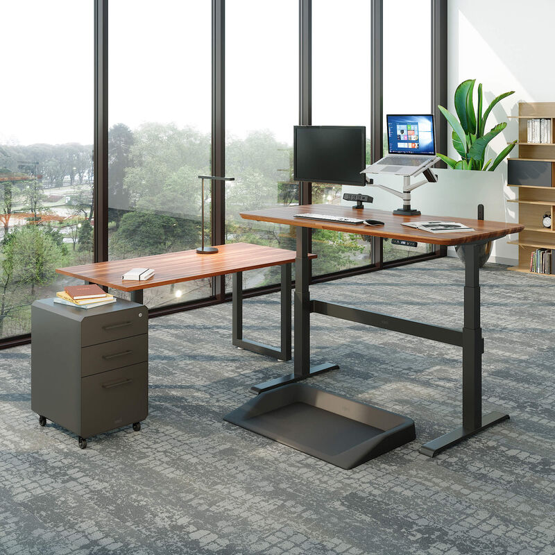 Electric Standing Desk and benching table in office with large windows image number null