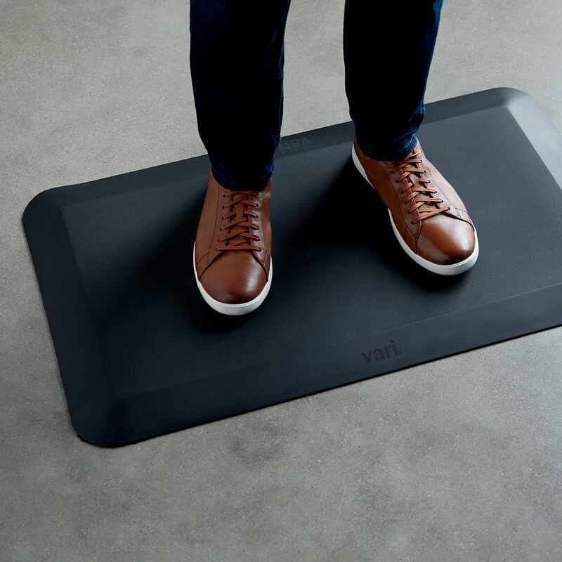 Standing Mat 34x20 Black in office with person standing on it image number null