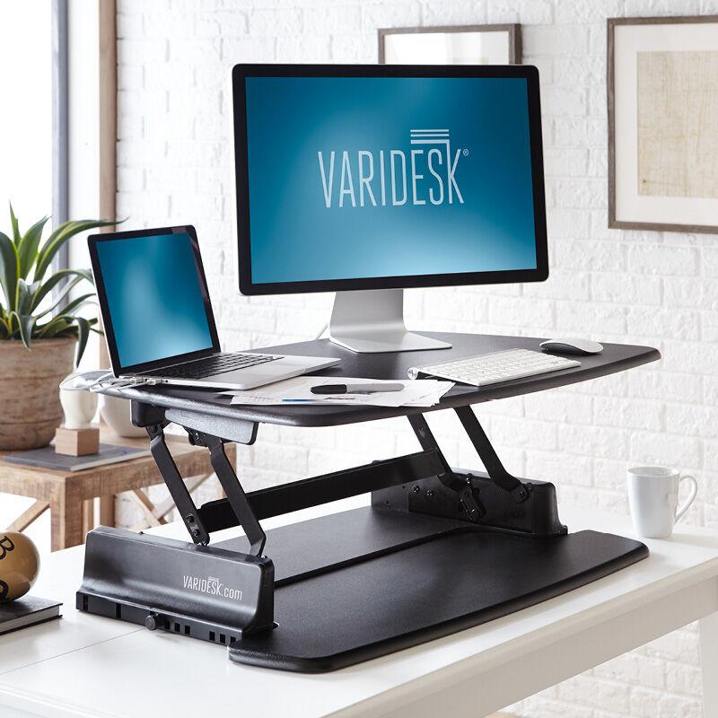 VariDesk Pro 36 Black sit-stand desk converter in raised position in office  image number null