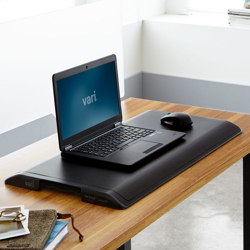 VariDesk® Laptop 30™ Black in lowered position at office image number null
