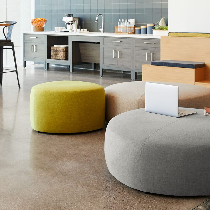 small light green ottoman in lounge setting image number null