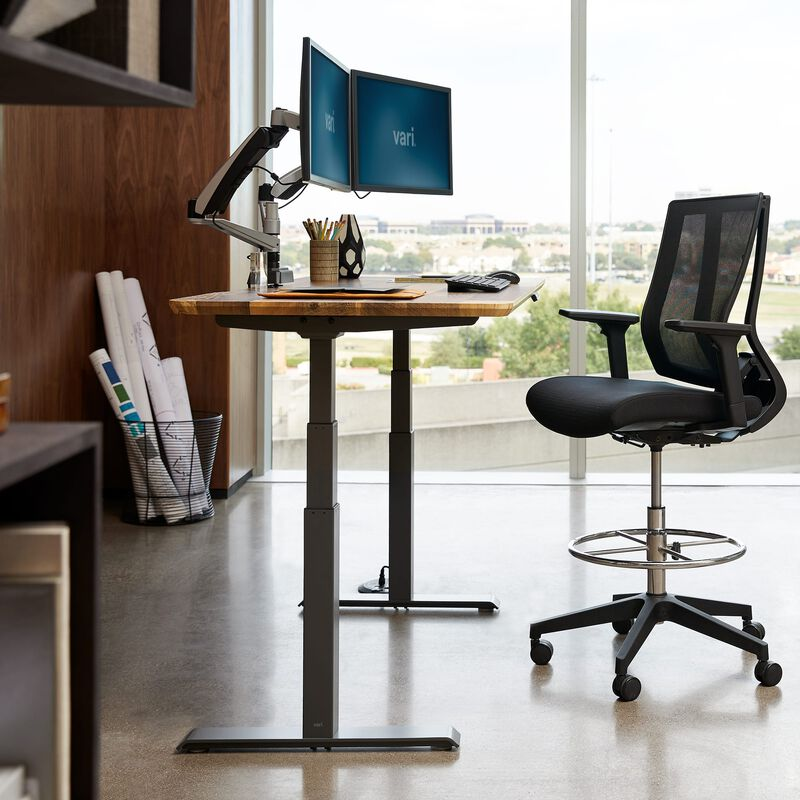 Electric Standing Desk 60x30 reclaimed wood in raised position at office image number null