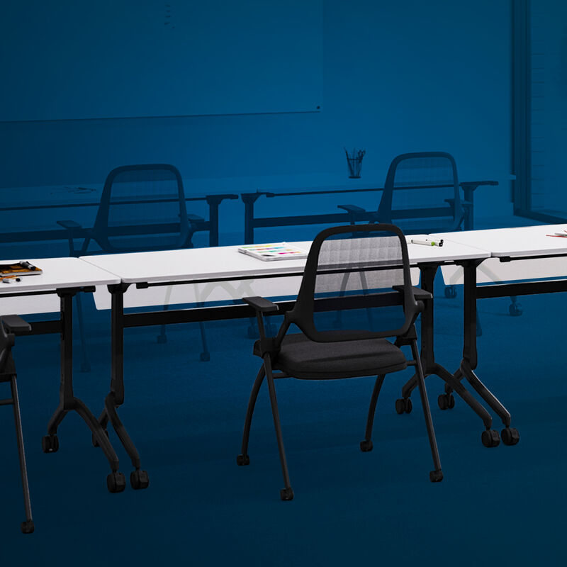 vari flip top training table five foot in white, nesting training chair, and flip top training table modesty panel five foot setup in an office training room with a blue overlay. image number null