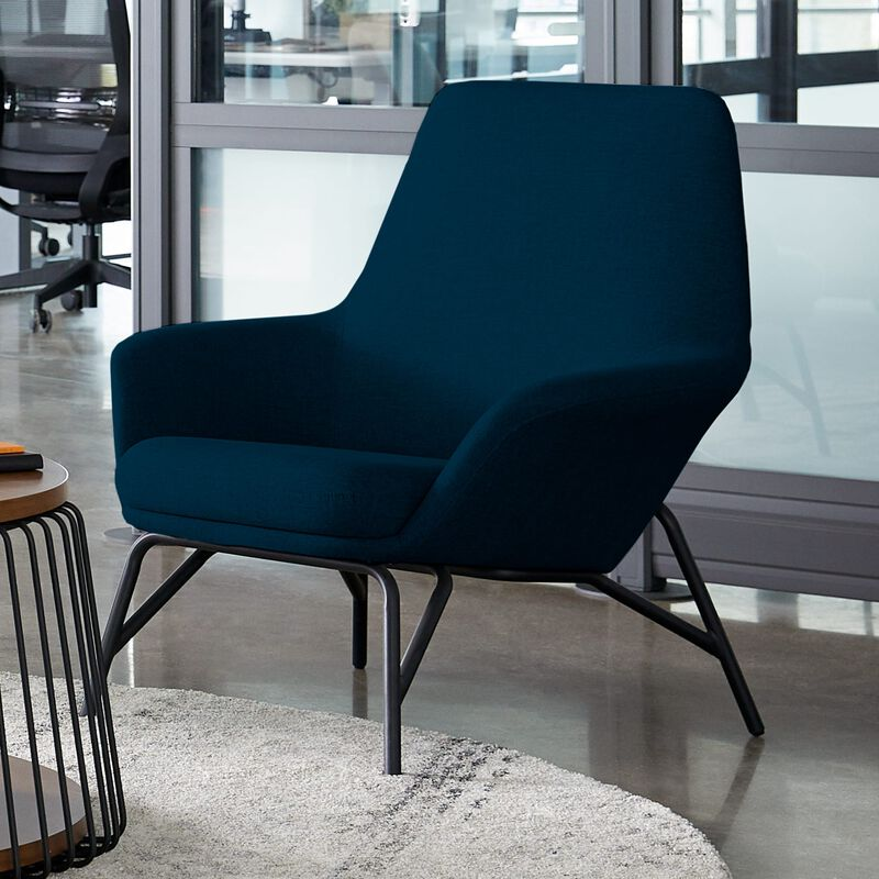navy arm chair in office setting image number null