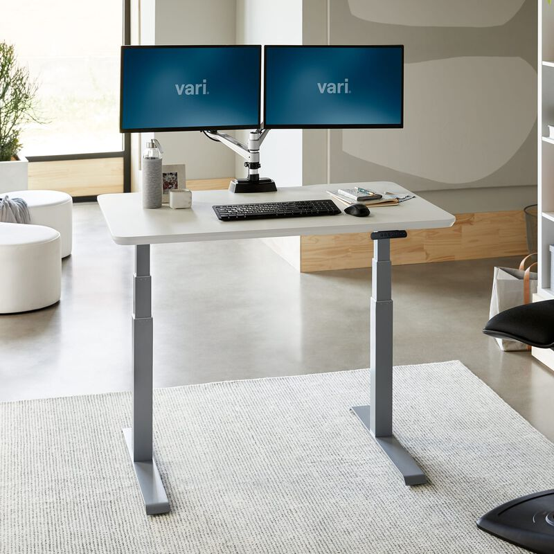Electric Standing Desk 48x30 White in raised position at office image number null