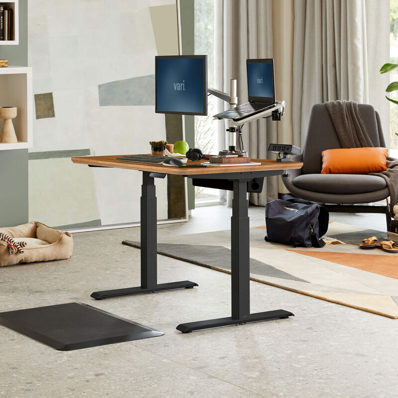 Electric Standing Desk 48x30 Butcher Block in lowered position at home image number null