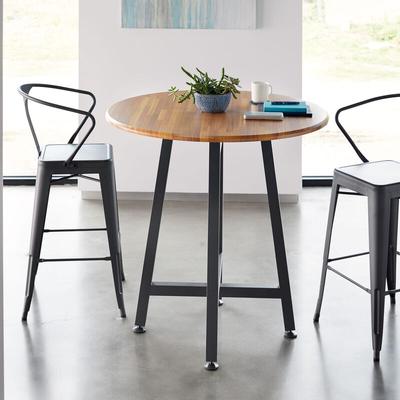 Standing Round Table Butcher Block shown with two chairs in office image number null