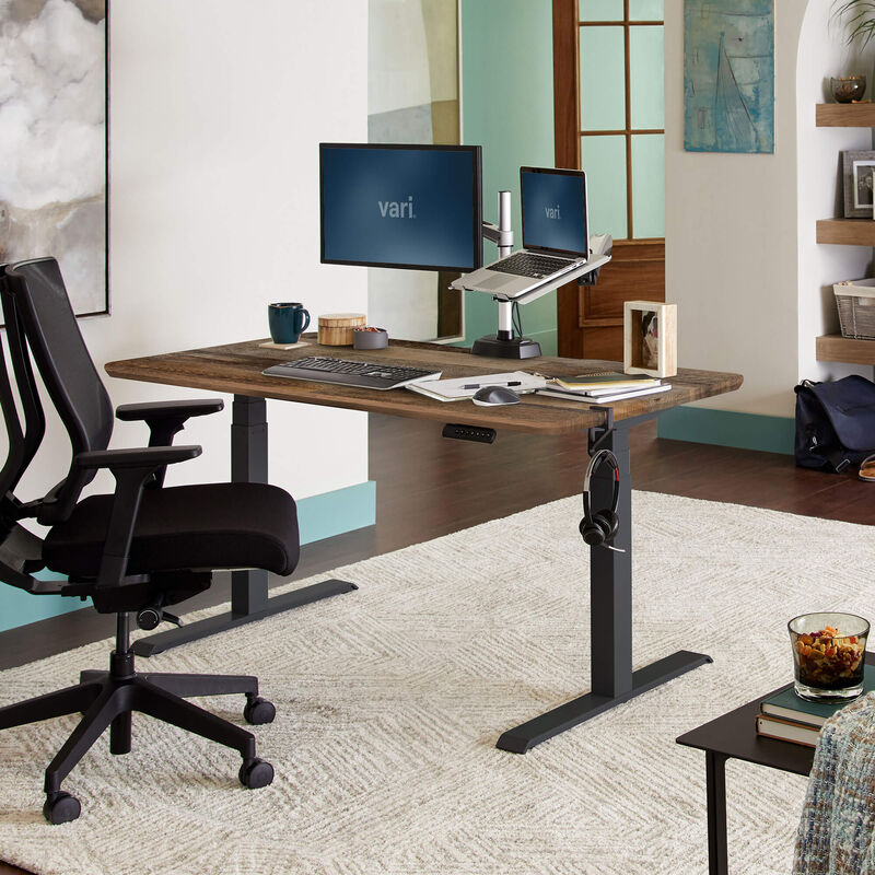 Electric Standing Desk 60x30 Reclaimed Wood in lowered position at home image number null