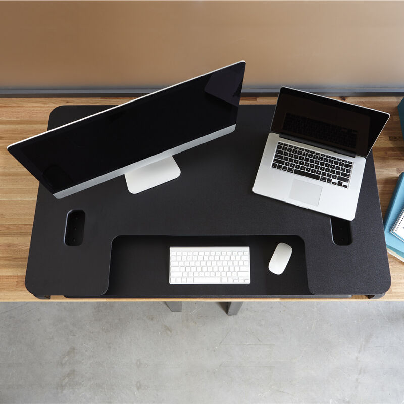 Overhead view of the VariDesk Pro Plus 48 Black sit-stand desk converter lowered on a wooden desk image number null