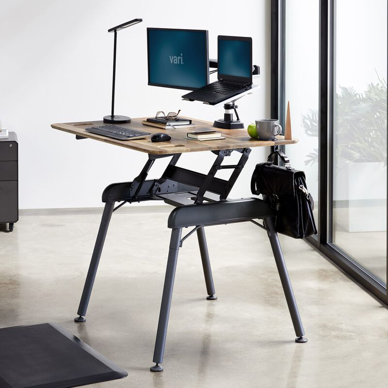 Standing Desk 48x32 Reclaimed Wood in raised position at office image number null