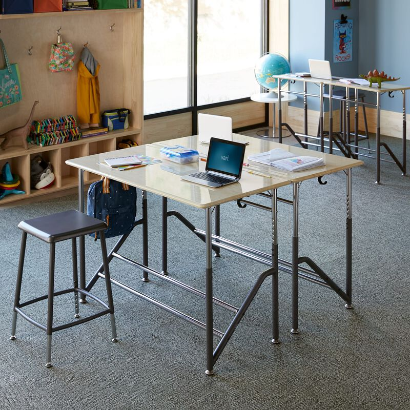 Four Standing School Desks for Two K-5 Maple grouped together in classroom at school image number null